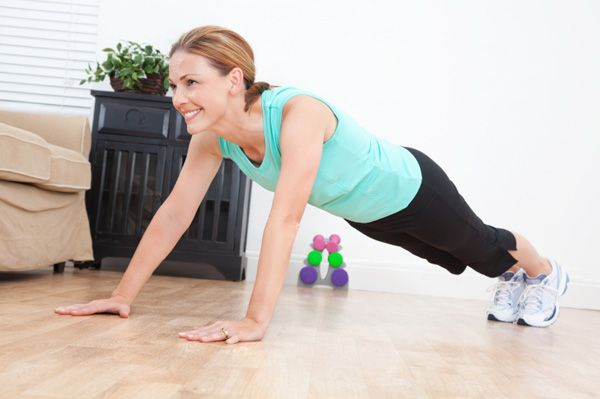 Lady doing push-ups at home